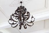 Antique Chandelier Hanging From White Ceiling
