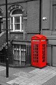 stock photo of phone-booth  - Red phone booth on background in black and white - JPG