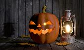 Halloween Pumpkin And Kerosene Lantern In A Wooden Barn