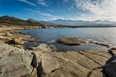 Corsican Coastline And Mountains At Punta Caldanu Near Lumio
