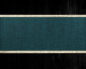 Dark jungle green rustic canvas banner textured with black wood background