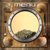 pic of scallop-shell  - Metal porthole with yellow lined paper fishing net scallop shells and silver cutlery - JPG