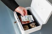 Businesswoman Put Five Euro Into Safe Box
