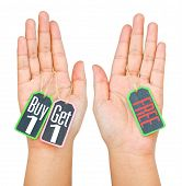 Buy 1 Get 1 Label Tag On Women Hand Isolated On White Background.