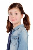 Adorable girl with pigtails looking at camera isolated on a white background
