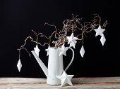Hanging white Christmas stars on black background