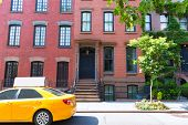 West Village in New York Manhattan building yellow cab USA NYC