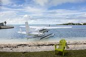 seaplane next to beach at tropical resort in bahamas