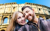 Beautiful Couple taking a selfie photo in Rome, Italy