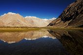 snow mountain range and reflection Leh Ladakh ,India
