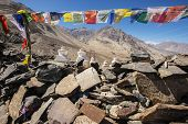 Stupa and player flags near Diskit monastery in Ladakh, Jammu & Kashmir, India - September 2014