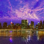 Manhattan New York skyline at sunset rainy dusk from East River NYC USA