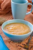 Dietary Pumpkin Porridge In The Blue Plate On An Orange Knitted Plaid