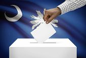 Voting Concept - Ballot Box With Us State Flag On Background - South Carolina