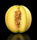 Melon Galia Notched With Seeds Isolated Black In Studio