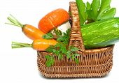 Fresh Vegetables And Herbs In A Basket Closeup On A White Background