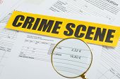 Magnifying Glass Over Documents With Crime Scene Tape