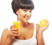 brunette woman holding orange juice