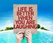 Life is Better When You Are Laughing card with a beach on background