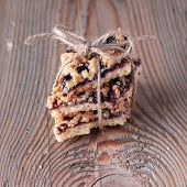 Handmade Cookies With Rope In A Ribbon On A Wooden Background