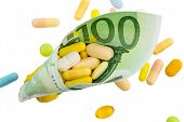 tablets and one hundred euro banknote symbol photo: charges for medicine and drugs the pharmaceutical industry
