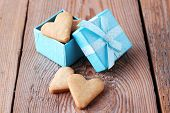Heart Shaped Cookies In A Blue Gift Box On A Wooden Background