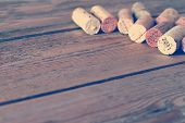 Wine Corks Lying On A Wooden Table