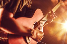 stock photo of string instrument  - Acoustic Guitar Playing. Men Playing Acoustic Guitar Closeup Photography. ** Note: Shallow depth of field - JPG