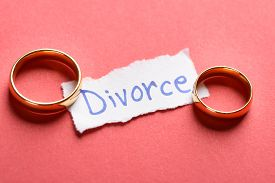 stock photo of split ends  - Golden Rings On Torn Piece Of Paper With Divorce Text - JPG