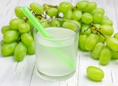 image of grape  - Glass of white grapes juice and grapes on background - JPG