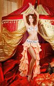 foto of harem  - Sexy oriental beauty dancing in front of the tent - JPG