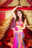 image of belly-dance  - Sexy oriental beauty dancing belly dance in front of the tent - JPG