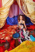 stock photo of harem  - Sexy oriental beauty and tabla - JPG