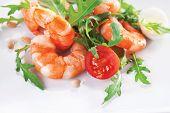 foto of tiger prawn  - Salad of king prawns and rukola in a white plate - JPG