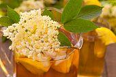 image of elderberry  - Elderberry flower drink with sliced lemon and ice - JPG