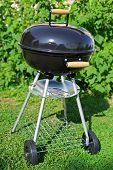 picture of kettles  - Kettle barbecue grill in summer garden outside nobody - JPG