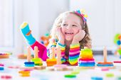 pic of kindergarten  - Child playing with wooden toys at preschool - JPG