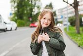 image of khakis  - Outdoor portrait of a cute little girl - JPG