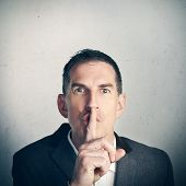 picture of shh  - Adult business man in suit saying Shhhh - JPG