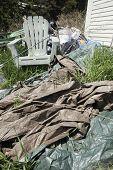 image of tarp  - Garbage in back yard of house in grass - JPG