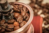 stock photo of wooden box from coffee mill  - Closeup picture of coffee bean grinder and coffee bean - JPG