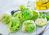 pic of brussels sprouts  - brussel sprouts on board and on a table - JPG