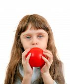 image of girlie  - Little Girl inflate a Red Balloon on the White Background - JPG