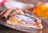 pic of pie-in-face  - apple pie on plate and on a table - JPG
