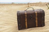 foto of treasure  - Treasure chest in sand dunes on a beach - JPG