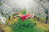 image of levitation  - Romantic levitating blonde beauty - JPG