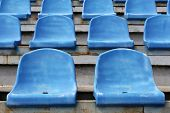 image of grandstand  - Empty blue seats in stadium - JPG