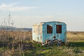 foto of shacks  - an old metal shack used by construction workers in a field near Targu - JPG
