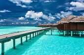 image of jetties  - Overwater villas on the tropical lagoon connected to island by jetty - JPG