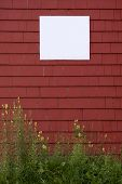 Red Wall With Blank Sign